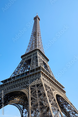 Eiffel Tower in Paris in a sunny day, low angle view and clear blue sky - 259802980