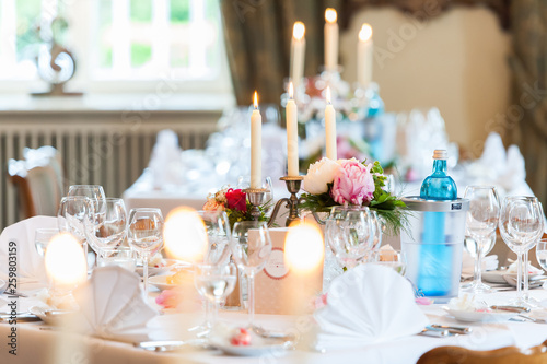 wedding table decoration with candles and flowers - 259803159