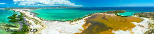 Aerial view of Puerto Rico. Faro Los Morrillos de Cabo Rojo. Playa Sucia beach and Salt lakes in Punta Jaguey.  - 259832578