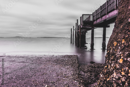 Coastal pier on cloudy day © Anand
