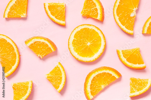 Fruit pattern of fresh orange slices on pastel background. Top view. - Image © ireneromanova