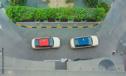 fototapeta na ścianę taxi cars waiting in front of hotel. aerial view