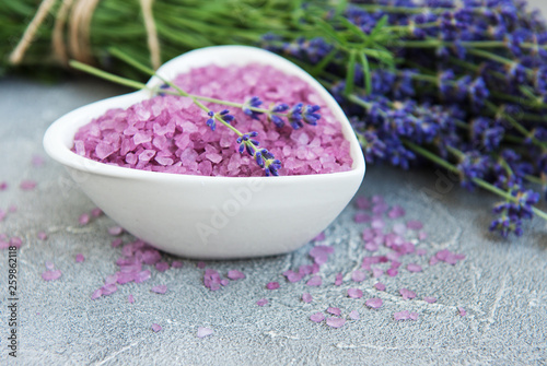 Heart-shaped bowl with sea salt and fresh lavender flowers - 259862118