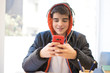 teenager or student with mobile phone and headphones