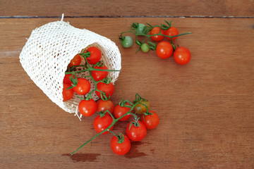 Small Tomato spill out of basket.Food concept.