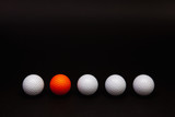 Golf balls on the black table.