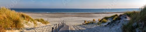 Beach on the East Frisian Island Juist in the North Sea, Germany, in morning light. - 259876767