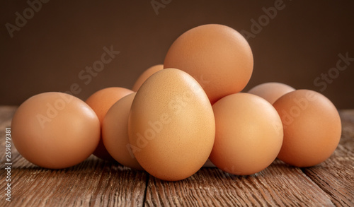 pile of chicken eggs on wooden background - 259879381