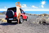 Slim young woman with red car and sea landscape
