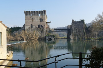 panorama of Roman bridge on Mincio river from the medieval village of Borghetto