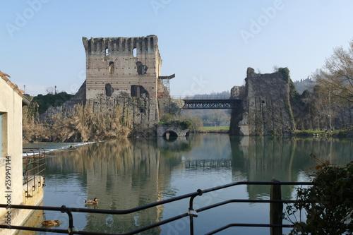 panorama of Roman bridge on Mincio river from the medieval village of Borghetto