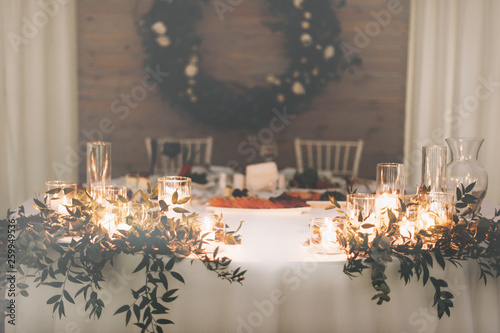 A beautiful and festive bride and groom table in night © cristalov