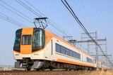 The limited express train running under the sunny sky in Japan .
