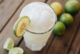 Lime shake in glass at wooden background