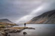 Stunning long exposure landscape image of Wast Water in UK Lake District during moody Spring evening