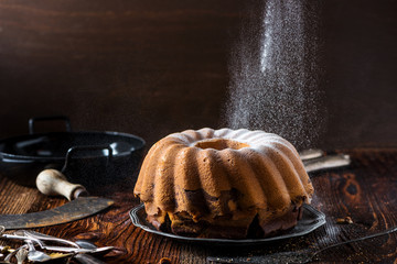 Delicious home-baked marble cake served on a wooden board with rustic decoration (baked by Alina Tschemernjak)