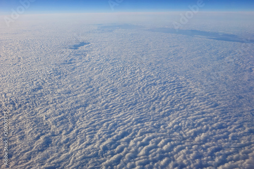 flight above the clouds - 260009375