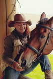 Fototapeta Fototapety z końmi - cowgirl with her horse © Iliya Mitskavets