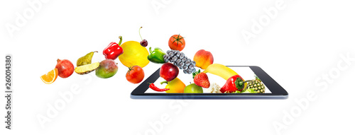 Fresh vegetables and fruits, flying, falling, into a shopping cart in a modern gadget, mobile phone, isolated on a white background. Creative idea online shopping.