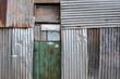Old metal sheet house facade