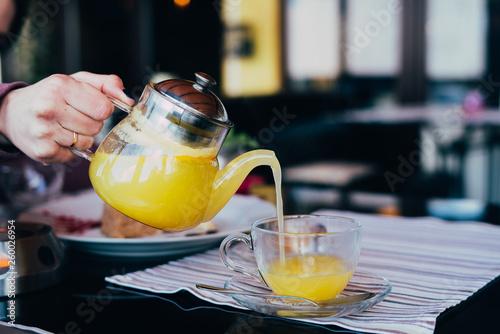 woman pour tea glass teapot © Александра Вишнева