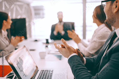 Group of businesspeople sitting at boardroom at meeting and clapping. Get into the habit of asking yourself if what you are doing can be handled by someone else. © dusanpetkovic1