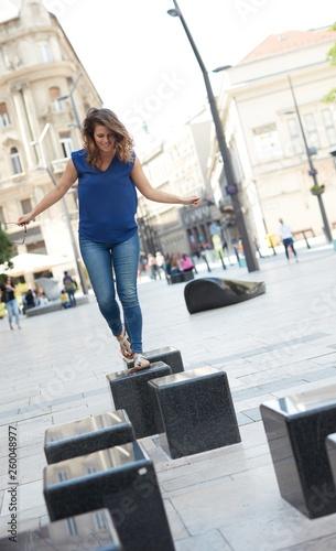 fototapeta na ścianę Young woman having fun in the city