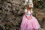 Beautiful blonde young woman wearing pink tulle skirt being sad at an abandoned place