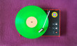 vintage seventies turntable with green vinyl record. The precise rendering of the black plastic surface is no picture noise. free copy space