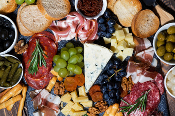 assorted gourmet cheeses and meats, top view