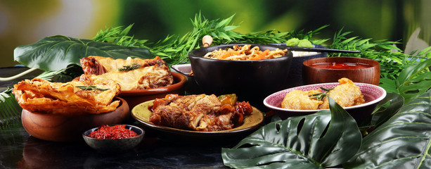 Assorted Chinese food set. Chinese noodles, fried rice, peking duck, dim sum, spring rolls. Famous Chinese cuisine dishes on table. Chinese restaurant © beats_