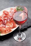 Wine glass and spanish jamon plate