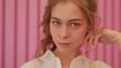 Model girl posing near pink wall