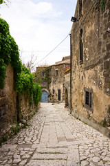narrow street, old houses in medieval village Casertavecchia, Campania, Italy