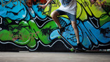 Fototapeta Teenage - Skater do it trick on ghetto graffiti background © phrmss