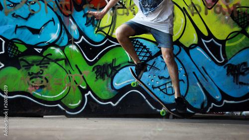 Skater do it trick on ghetto graffiti background - 260156319