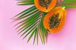 Half cut papaya on color background