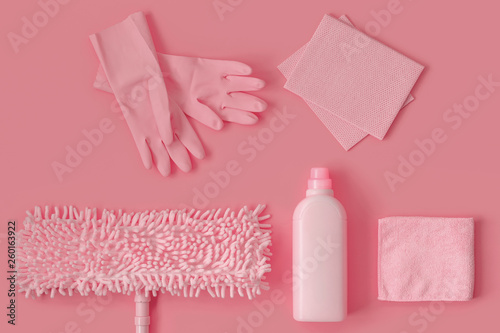 Pink cleaning kit in the house on a pink background. - 260163922