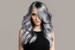 canvas print picture - Beautiful woman with long wavy coloring hair. Flat gray background.