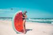Quadro Model with watermelon lilo at the beach