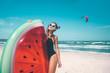 Leinwandbild Motiv Model with watermelon lilo at the beach