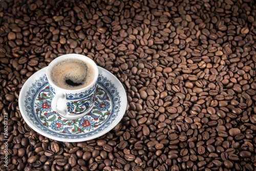 Cup of coffee beans background © Ekaterina Myshenko