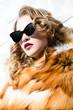 Leinwandbild Motiv sunglasses and fur