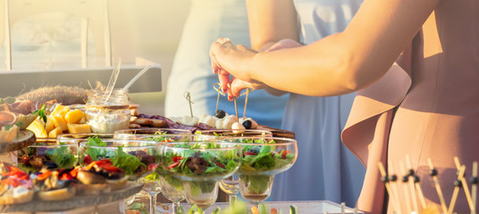 catering table set service with silverware and glass stemware at restaurant before party © Shcherbyna