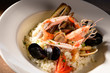 Quadro Rice with seafood on a plate in restauant ready to be served