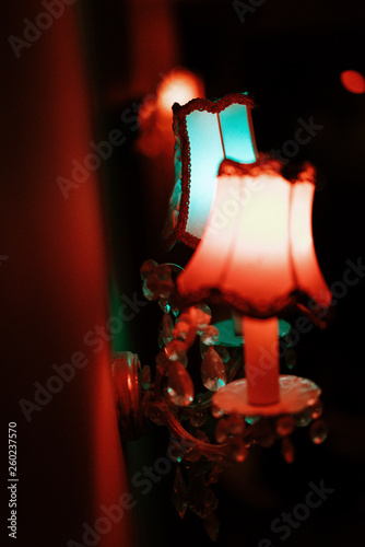 wall crystal sconces with pendants. red and blue lighting. similar to the effect of 3d. great decor for a pub or cafe. selective focus © Людмила Таможенко