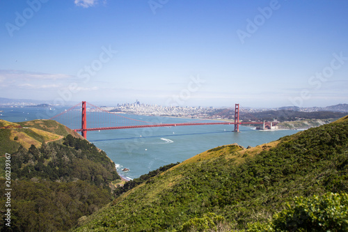 Golden Gate Bridge shot from a high point. Strait of the Golden Gate. Sunny weather and green vegetation. - 260239367