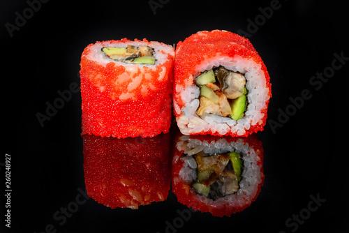 traditional fresh japanese sushi rolls on a black background - 260248927