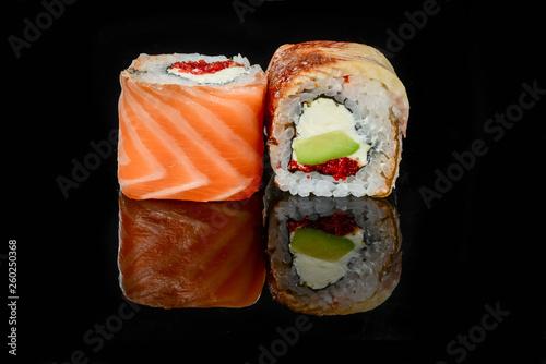 traditional fresh japanese sushi rolls on a black background - 260250368