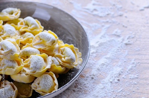 Preparing homemade tortellini. - 260253145